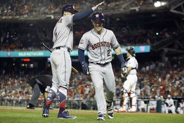 Houston Astros George Springer, left, congratulates teammate Alex Bregman after Bregman hit the go-ahead home run during the 10th inning at the All-star Game on Tuesday in Washington.