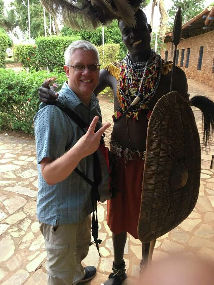 William Davis, a technology teacher at Rhodes Middle School, is shown in a photo he sent his daughter while traveling in Uganda. It was the last photo she received from her father, who died in an accident in Uganda. Photo: Davis Family