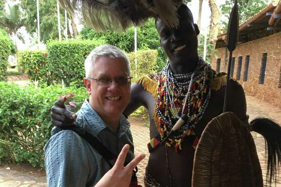 William Davis, a technology teacher at Rhodes Middle School, is shown in a photo he sent his daughter while traveling in Uganda. It was the last photo she received from her father, who died in an accident in Uganda.