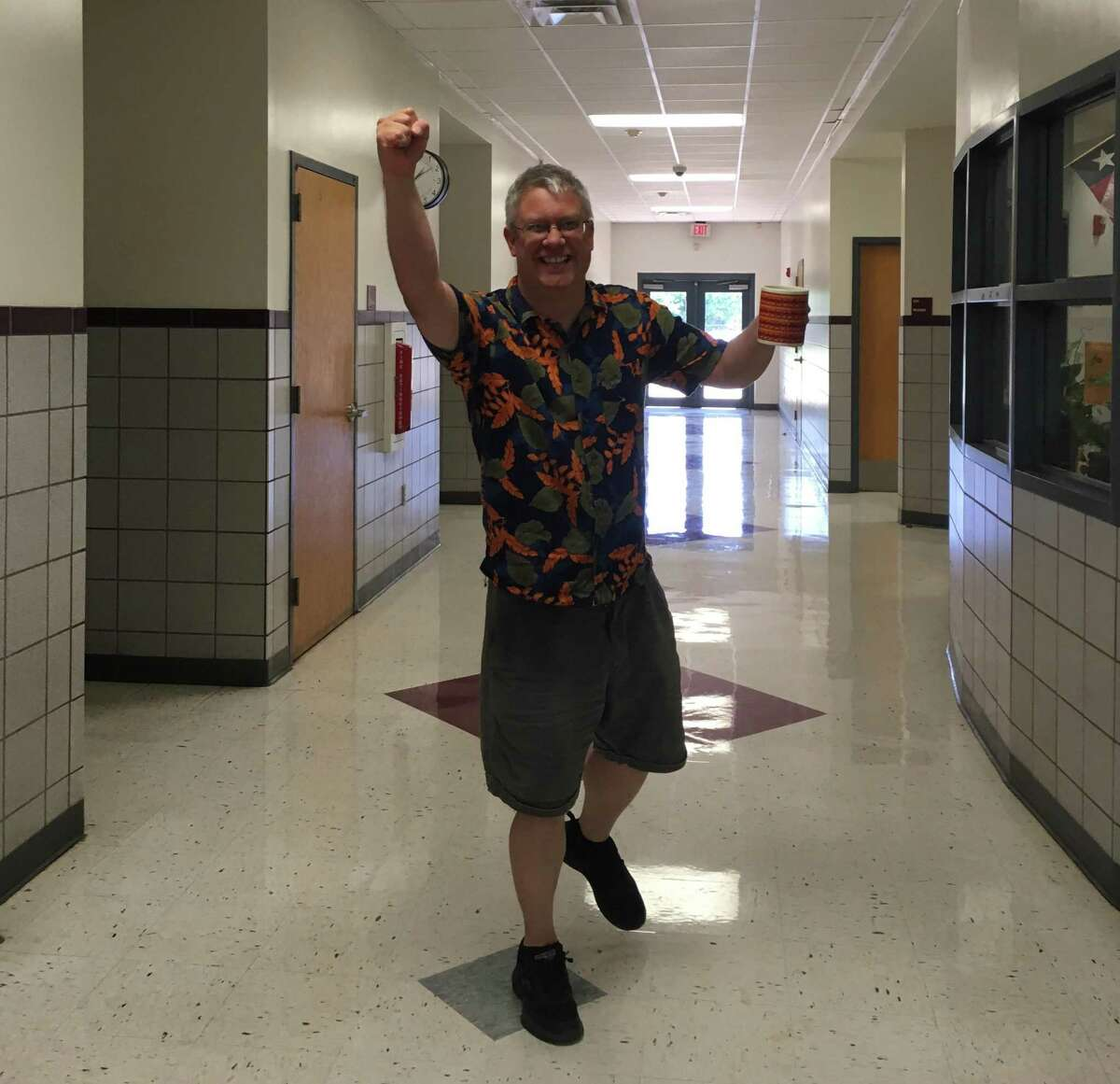 """Technology teacher, William Davis demonstrates his """"We got this"""" attitude in a hallway at Rhodes Middle School. Davis died Tuesday in a car accident while traveling in Uganda."""