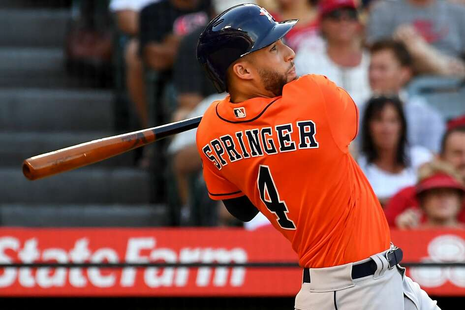 ANAHEIM, CA - JULY 21:George Springer #4 of the Houston Astros hits a grand slam home run in the sixth inning of the game off relief pitcher Taylor Cole #67 of the Los Angeles Angels of Anaheim at Angel Stadium on July 21, 2018 in Anaheim, California.  (Photo by Jayne Kamin-Oncea/Getty Images)