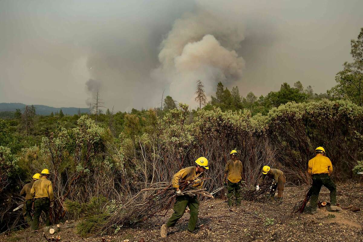 Firefighters from the Big Bear Hotshots create a firebreak as the Ferguson fire approaches in the Stanislaus National Forest, near Yosemite National Park, California, on July 21, 2018.