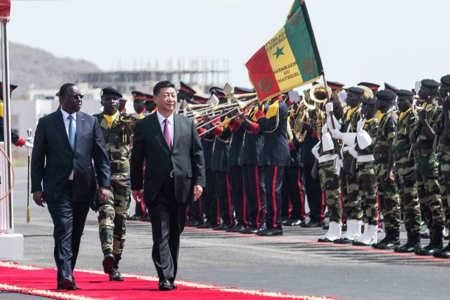 Senegal president Macky Sall, left, and Chinese President Xi Jinping, inspect the honour guard during a state visit in Dakar, Senegal, Saturday, July 21, 2018. Chinese President Xi Jinping arrived in Africa on Saturday on a four-nation visit, seeking deeper military and economic ties. (AP Photo/Xaume Olleros Photo: Xaume Olleros / 1.4 Images