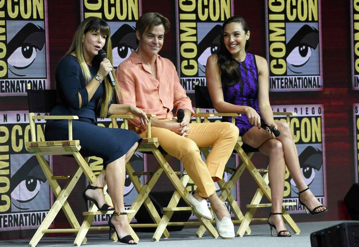 """Patty Jenkins, from left, Chris Pine and Gal Gadot speak at the Warner Bros. Theatrical panel for """"Wonder Woman 1984"""" on day three of Comic-Con International on Saturday, July 21, 2018, in San Diego. (Photo by Chris Pizzello/Invision/AP)"""