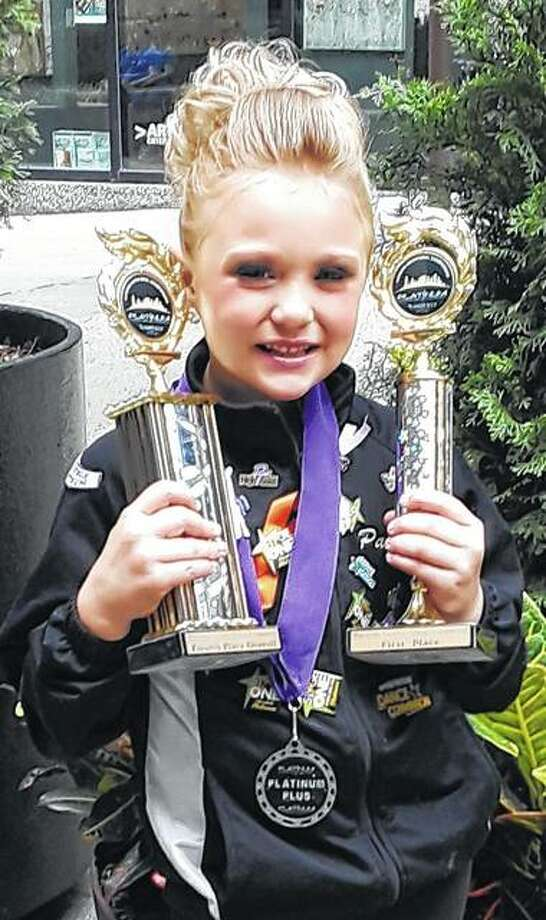 "Payten McCurley, 7, received the title of first place champion in her jazz category with a platinum-plus score for her solo dance, ""Queen Bee,"" during the Platinum Ultimate Dance Competition in July in Nashville, Tennessee. She also received fourth-place overall in the Nashville competition. Dancers from across the United States spent their weekend competing in the invitation-only event. Payten, a dancer with Steppin' Up Dance Company in Winchester, is the daughter of Ben and Stephanie McCurley. Photo:       Photo Provided"