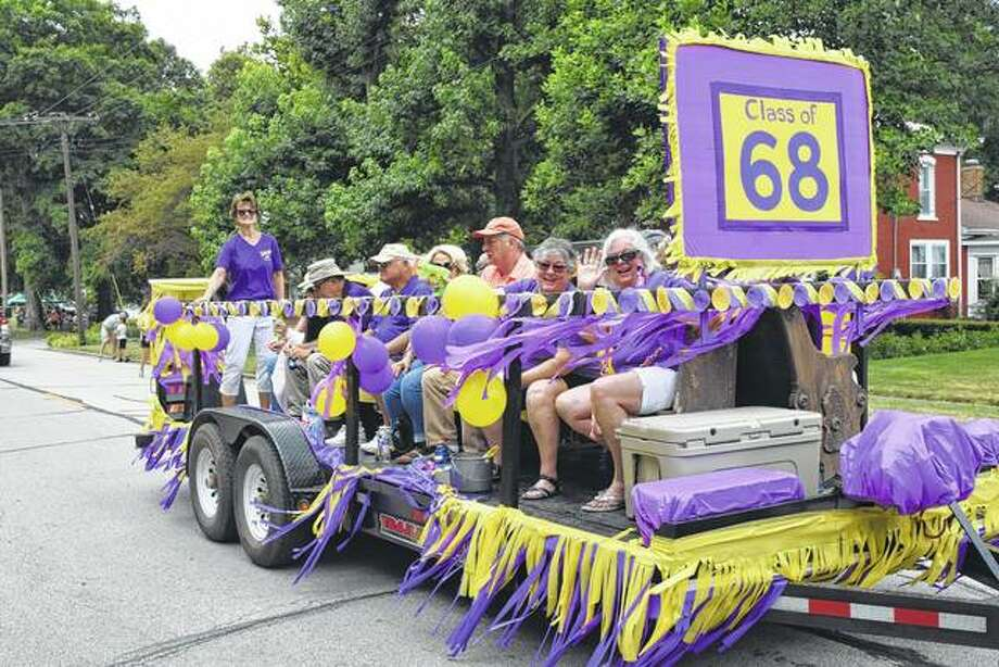 Members of the Winchester High School Class of 1968 ride in Saturday's Winchester Community Picnic parade. The procession down Main Street featured about 70 entries. Photo:       Greg Olson | Journal-Courier