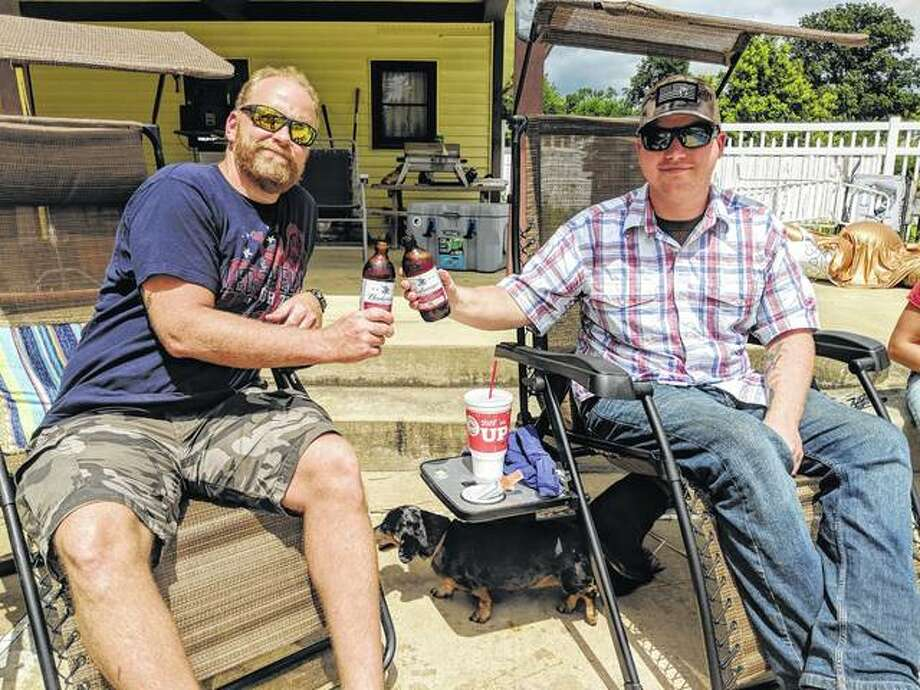 Jason French and his stepson Matthew Drane enjoy a beer Friday donated by Blake Kesterson of Kesterson's Good Times to celebrate Drane's return from Kuwait.