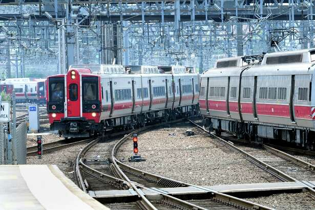 Metro North trains roll into Union Station in New Haven on Friday 8/3/2012. Photo by Arnold Gold/New Haven Register   AG0485E
