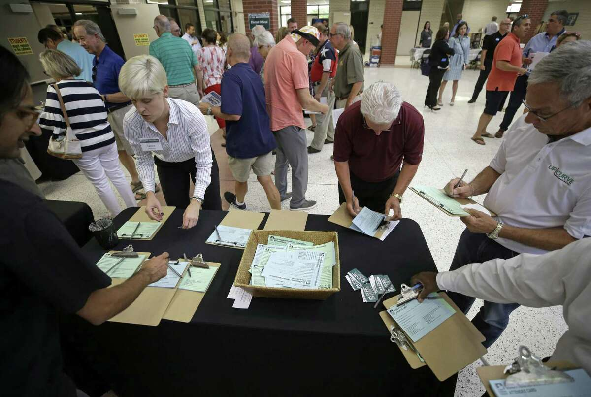 People fill out attendee cards at the Harris County Flood Control District bond program community meeting at Kingwood Park High School, 4015 Woodland Hills Drive Kingwood, Tuesday, July 10, 2018, in Houston. ( Melissa Phillip / Houston Chronicle )