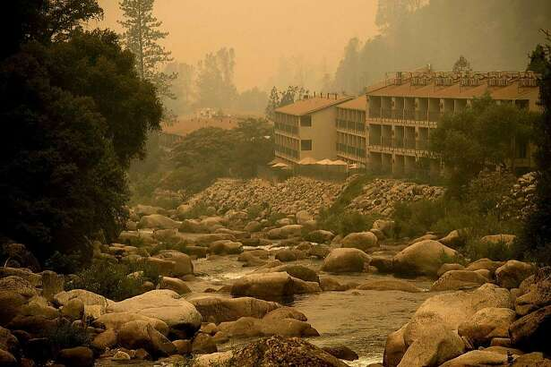 Smoke from the Ferguson fire hangs over the Yosemite View Lodge in El Portal, Yosemite National Park, California, on July 21, 2018. A fire that claimed the life of one firefighter and injured two others near California's Yosemite national park has almost doubled in size in three days, authorities said Friday. The US Department of Agriculture (USDA) said the so-called Ferguson fire had spread to an area of 22,892 acres (92.6 square kilometers), and is so far only 7 percent contained.   / AFP PHOTO / NOAH BERGERNOAH BERGER/AFP/Getty Images