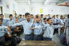 A class of 59 students at a public senior secondary school in Delhi take part in a happiness class that included a mix of yoga, music and ethics.
