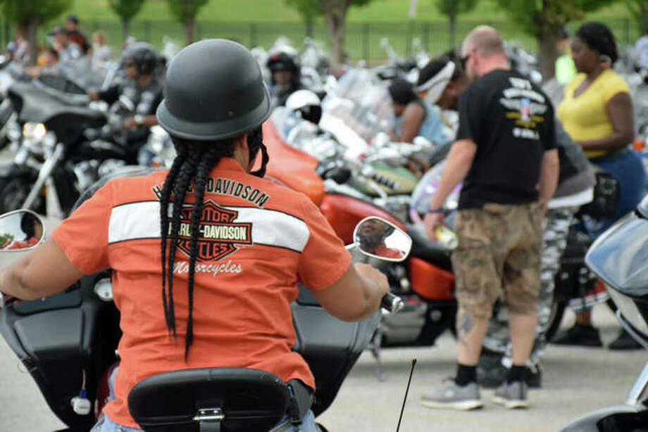 A woman waits to park her motorcycle among more than 250 others during Saturday's Bikes & BBQ Festival in downtown Alton. Photo:       David Blanchette | For The Telegraph