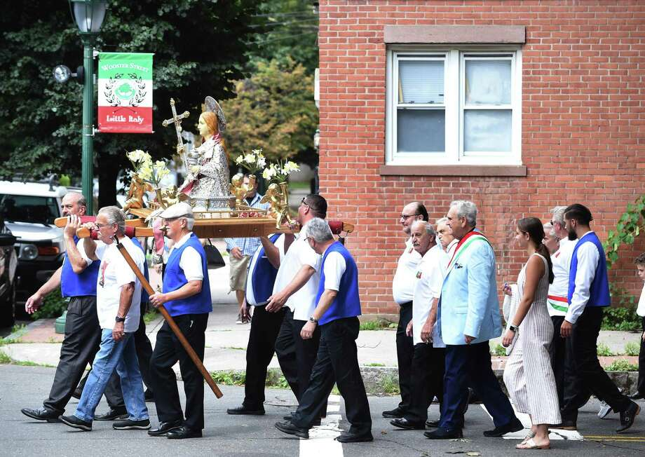 A procession following the statue of Santa Maria Maddalena turns onto Wooster Street in New Haven on the 120th anniversary of the Santa Maria Maddalena Society on the feast day of Saint Mary Magdalene on July 22, 2018. Photo: Arnold Gold / Hearst Connecticut Media / New Haven Register