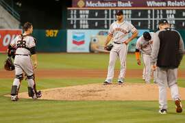San Francisco Giants starting pitcher Madison Bumgarner (40) is taken out of the MLB game against the Oakland Athletics at the Oakland Coliseum on Saturday, July 21, 2018, in Oakland, Calif. For the first time in 13 years, the A�s opened Mount Davis, the tallest deck in the Oakland Coliseum.