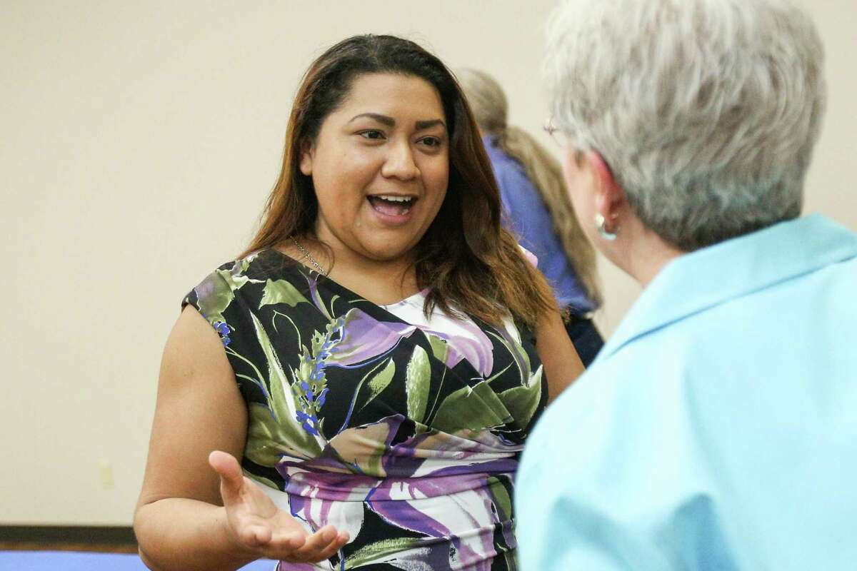 Sema Hernandez, candidate for U.S. Senate, speaks with residents during the meet and greet with state and local Democratic Party candidates.