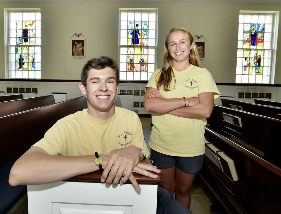 Michael Campanelli, 18, of Madison, left, and Allie Stankewich, 17, of Guilford, members of St. George Catholic Church in Guilford, participated in a weeklong mission trip to Haiti recently to help serve in hospitals, orphanages and schools and to connect culturally with the people of the Caribbean country. A total of 38 teens from St. George Church traveled to Haiti on two mission trips this summer. Photo: Peter Hvizdak / Hearst Connecticut Media / New Haven Register