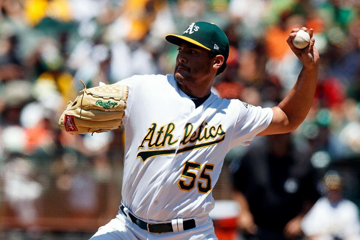 Sean Manaea #55 of the Oakland Athletics pitches against the San Francisco Giants during the first inning at the Oakland Coliseum on July 22, 2018 in Oakland, California.