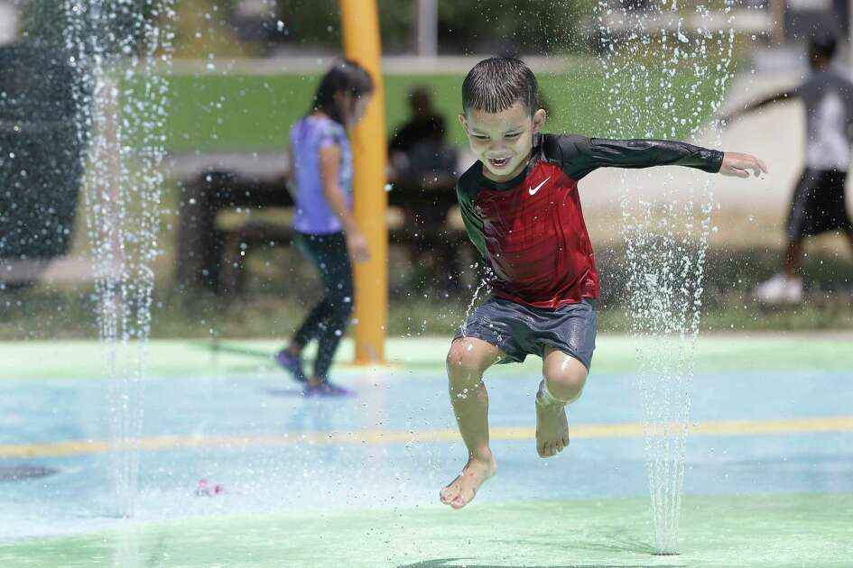 Alex Fabian, 3, cools off on the water playground at Burnett Bayland Park, 6000 Chimney Rock Rd., Sunday, July 22, 2018, in Houston.