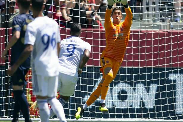 Manchester United goaltender Joel Pereira saves a San Jose Earthquakes shot on goal during the first half of a soccer game, Sunday, July 22, 2018, in Santa Clara, Calif. (AP Photo/D. Ross Cameron)