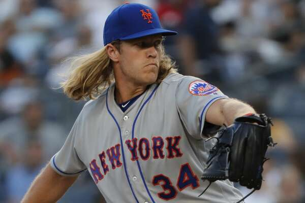 New York Mets starting pitcher Noah Syndergaard (34) delivers against the New York Yankees during the first inning of a baseball game, Friday, July 20, 2018, in New York. (AP Photo/Julie Jacobson)