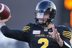 HAMILTON, ON - JULY 19:  Johnny Manziel #2 of the Hamilton Tiger-Cats warms up prior to action against the Saskatchewan Roughriders in a CFL game at Tim Hortons Field on July 19, 2018 in Hamilton, Ontario,Canada. (Photo by Claus Andersen/Getty Images)