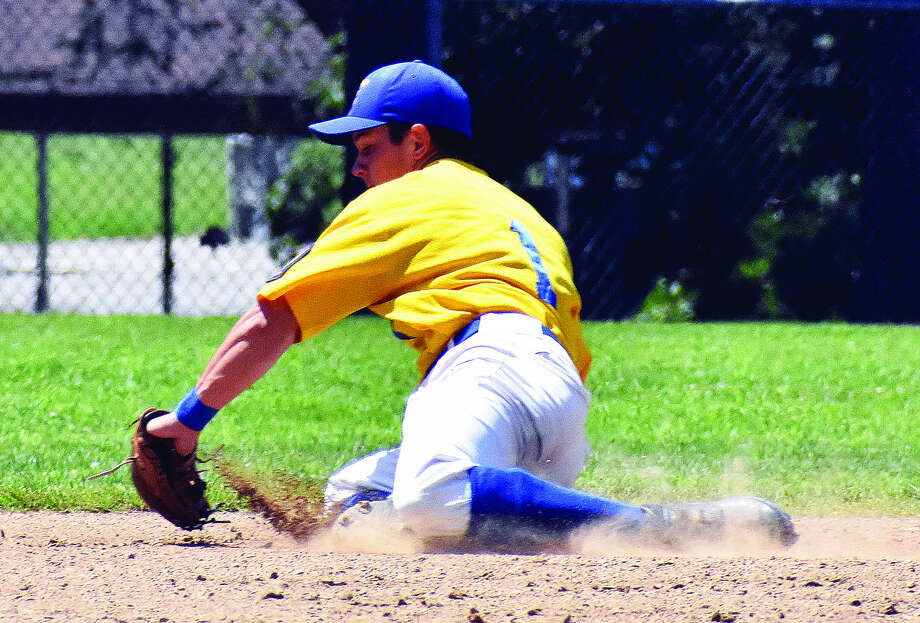 Post 199 shortstop Tate Wargo makes a diving stop in the hole to lead to a force out at second base on Satuday in Aviston. Photo: Matthew Kamp
