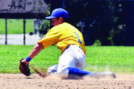 Post 199 shortstop Tate Wargo makes a diving stop in the hole to lead to a force out at second base on Satuday in Aviston.