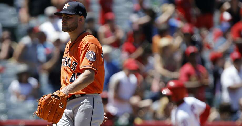 Houston Astros starting pitcher Lance McCullers Jr., left, kicks the mound, as Los Angeles Angels' Justin Upton rounds third, after hitting a two-run home run, during the third inning of a baseball game in Anaheim, Calif., Sunday, July 22, 2018. (AP Photo/Alex Gallardo) Photo: Alex Gallardo/Associated Press