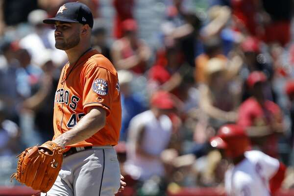 Houston Astros starting pitcher Lance McCullers Jr., left, kicks the mound, as Los Angeles Angels' Justin Upton rounds third, after hitting a two-run home run, during the third inning of a baseball game in Anaheim, Calif., Sunday, July 22, 2018. (AP Photo/Alex Gallardo)