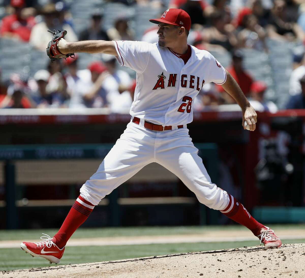 Los Angeles Angels starting pitcher Andrew Heaney delivers to a Houston Astros batter during the second inning of a baseball game in Anaheim, Calif., Sunday, July 22, 2018. (AP Photo/Alex Gallardo)