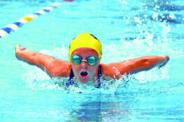 Rachel Johnson of Sunset Hills competes in the girls' 9-10 100-yard individual medley during Sunday's SWISA Swim Championships at Summers Port in Godfrey.