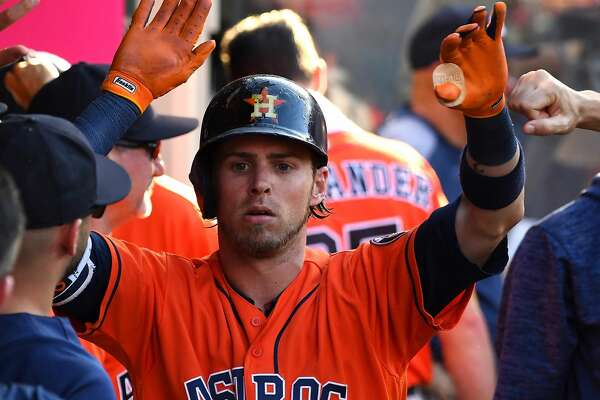 ANAHEIM, CA - JULY 21:  Josh Reddick #22 of the Houston Astros is congratulated in the dugout after a solo home run in the sixth inning of the game against the Los Angeles Angels of Anaheim at Angel Stadium on July 21, 2018 in Anaheim, California.  (Photo by Jayne Kamin-Oncea/Getty Images)
