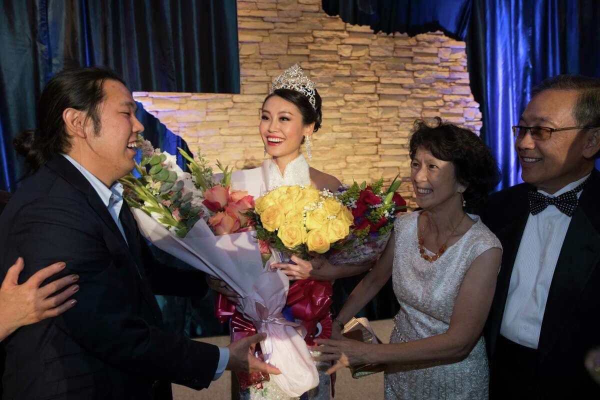 (LtoR) Jonathan Mok, Miss Chinatown Houston winner Karen Yen, Alice Hung, and C. A. C. A. President Henry Chan during the 48th Annual Miss Chinatown Houston Scholarship Pageant, Saturday, July 21, 2018.