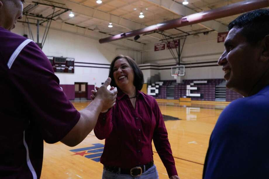 PHARR, TEXAS - July 9, 2018: Adrian Karr, 46, left, Amy Anders, 57, middle, and Freddy Aranda, 47, right. Anders was their varsity basketball coach in the PSJA School District from 1989 to 1990. Veronica G. Cardenas / For the San Antonio Express-News Photo: Veronica G. Cardenas / Veronica G. Cardenas