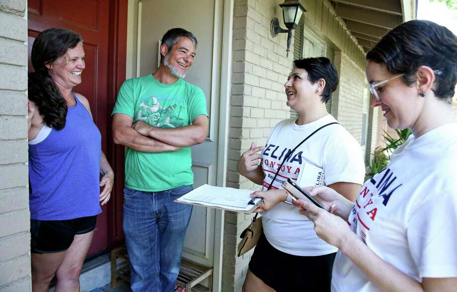 Celina Montoya (center) talks with Doug Sims and Beth Sims at the front door of their home on the north side as Democrats in red districts in San Antonio mount their campaigns to take state office on July 14, 2018.  Working with Montoya is campaign volunteer Alisha King (right). Photo: Tom Reel, Staff / Staff Photographer / 2017 SAN ANTONIO EXPRESS-NEWS
