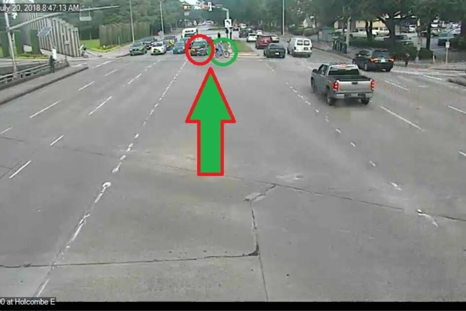 Dr. Mark Hausknecht can be seen in the green circle and the shooting suspect behind him in red. Hausknecht is headed north at 6700 Main and crossing into the W. Holcombe intersection. The shooting happened moments later, one block away.