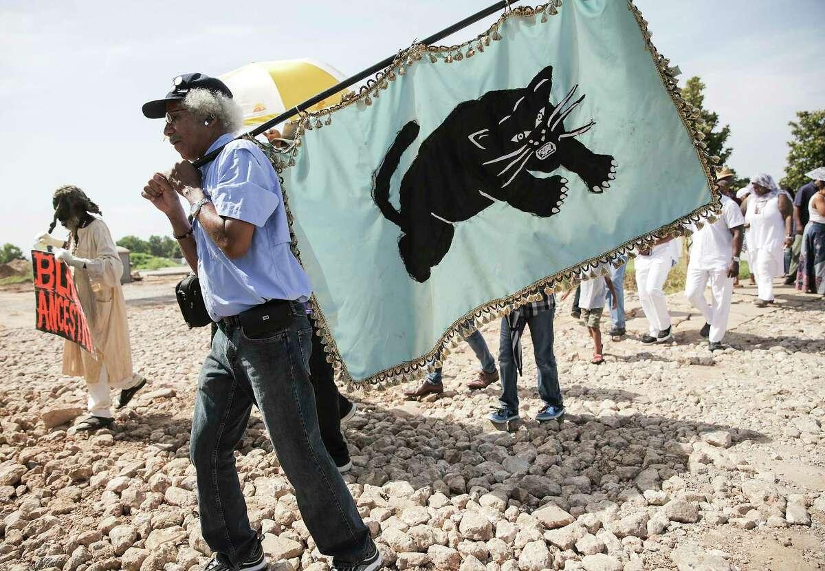 Carrying a Black Panther flag, John