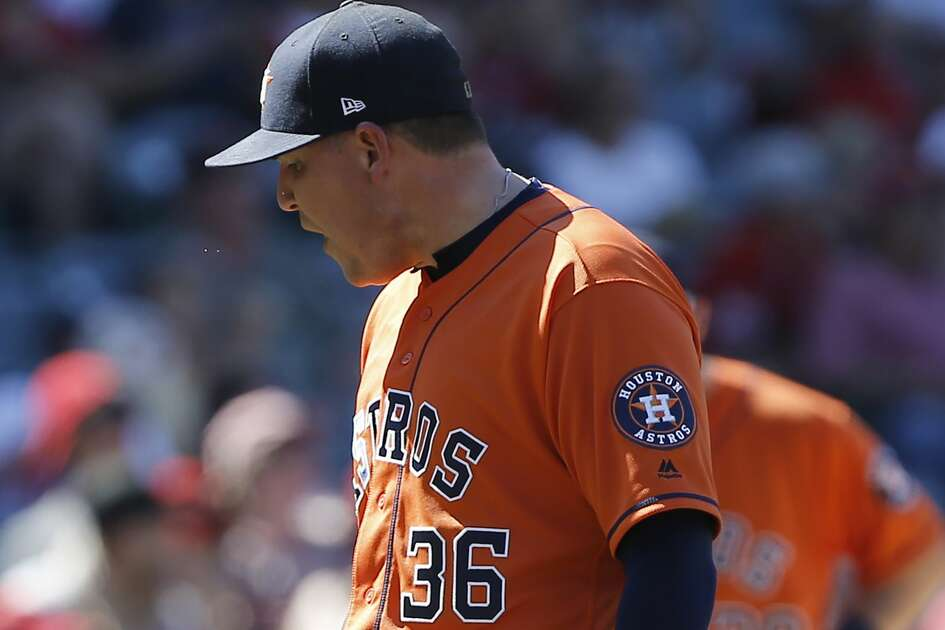 Houston Astros relief pitcher Will Harris reacts after giving up a two-run single to Los Angeles Angels' David Fletcher during the seventh inning of a baseball game in Anaheim, Calif., Sunday, July 22, 2018. (AP Photo/Alex Gallardo)