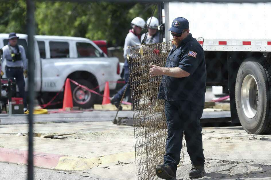 Emergency personnel remove debris from the scene of a fire at the Iconic Village Apartments in San Marcos, Texas, Sunday, July 22, 2018. Emergency personnel have recovered three bodies and two remain unaccounted. The fire started at 4:30 a.m. and affected about 200 residents.