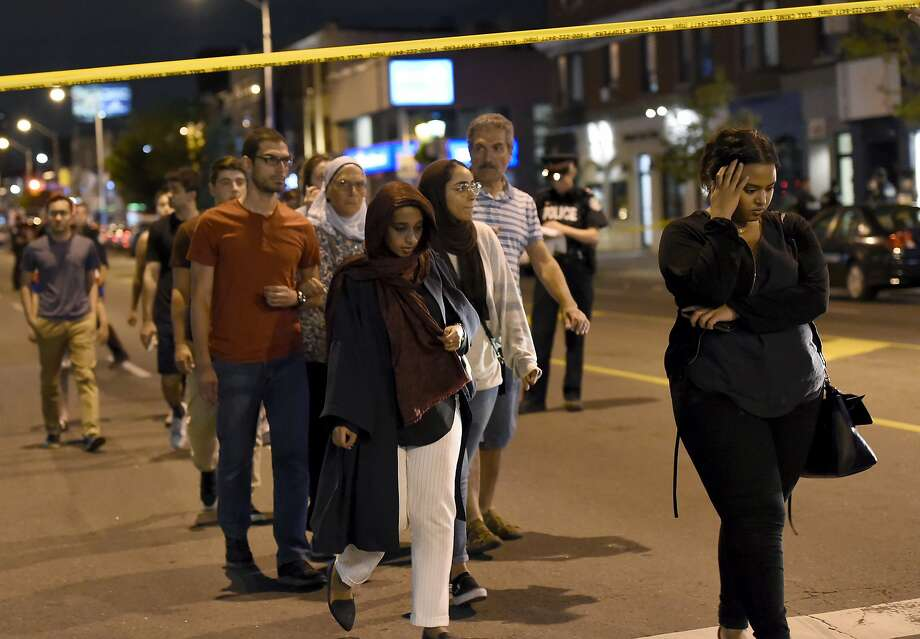 Civilians are escorted from the scene of a shooting in Toronto on Sunday, July 22, 2018. (Nathan Denette/The Canadian Press via AP) Photo: Nathan Denette, Associated Press