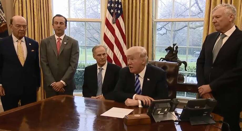 Charter Communications CEO Thomas Rutledge, far right, with President Donald Trump in the Oval Office in March 2017. Photo: The White House