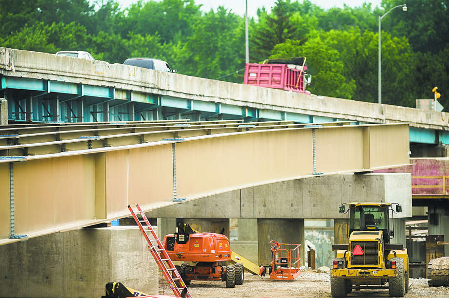 New steel beams are visible as construction continues on the M-20/Karl B. Robertson bridge on Friday afternoon. (Katy Kildee/kkildee@mdn.net) Photo: Katy Kildee/kkildee@mdn.net