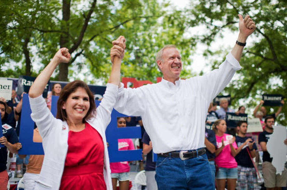 Gov. Bruce Rauner and running mate Evelyn Sanguinetti wave to the crowd during Republican Day at the Illinois State Fair in 2014.