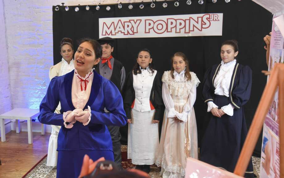 Mary Poppins Jr. cast members sing a selection of songs from the upcoming play during a meet and greet event. Photo: Danny Zaragoza/Laredo Morning Times