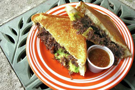 Barbacoa grilled cheese at Barrio Barista  Barbacoa's a birthright for the De Hoyos family. First with patriarch Jose, who opened his meat market at this corrugated steel building in the late '60s, and now with his son, Gilbert, who resurrected the property as a West Side coffee shop with a beatnik vibe in 2014. His barbacoa grilled cheese is a study in velvet textures, with glossy cheek meat and melted American cheese folded into buttered Texas toast for $5. Add avocado for 50 cents, if you're doing it right. Then add an icy horchata latte to do it  righter. Right on. 3735 Culebra Road, 210-519-5403, barriobarista.coffee.