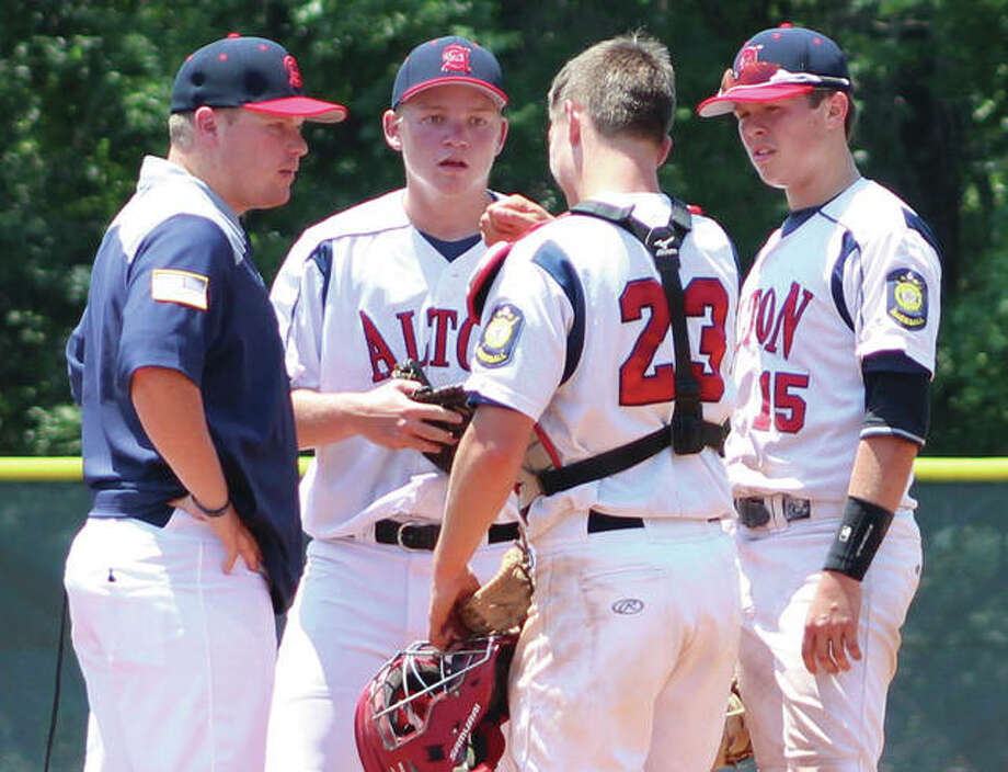 Alton manager Nick Paulda (left) huddles on the mound with (from left) pitcher Zach Knight, catcher Cullen McBride and first baseman Adam Stilts during a June 10 game against Jefferson City at Ballwin, Missouri. Post 126 returns to action this weekend as host of the Senior Legion State Tournament at Alton High in Godfrey. Photo:       Greg Shashack / The Telegraph