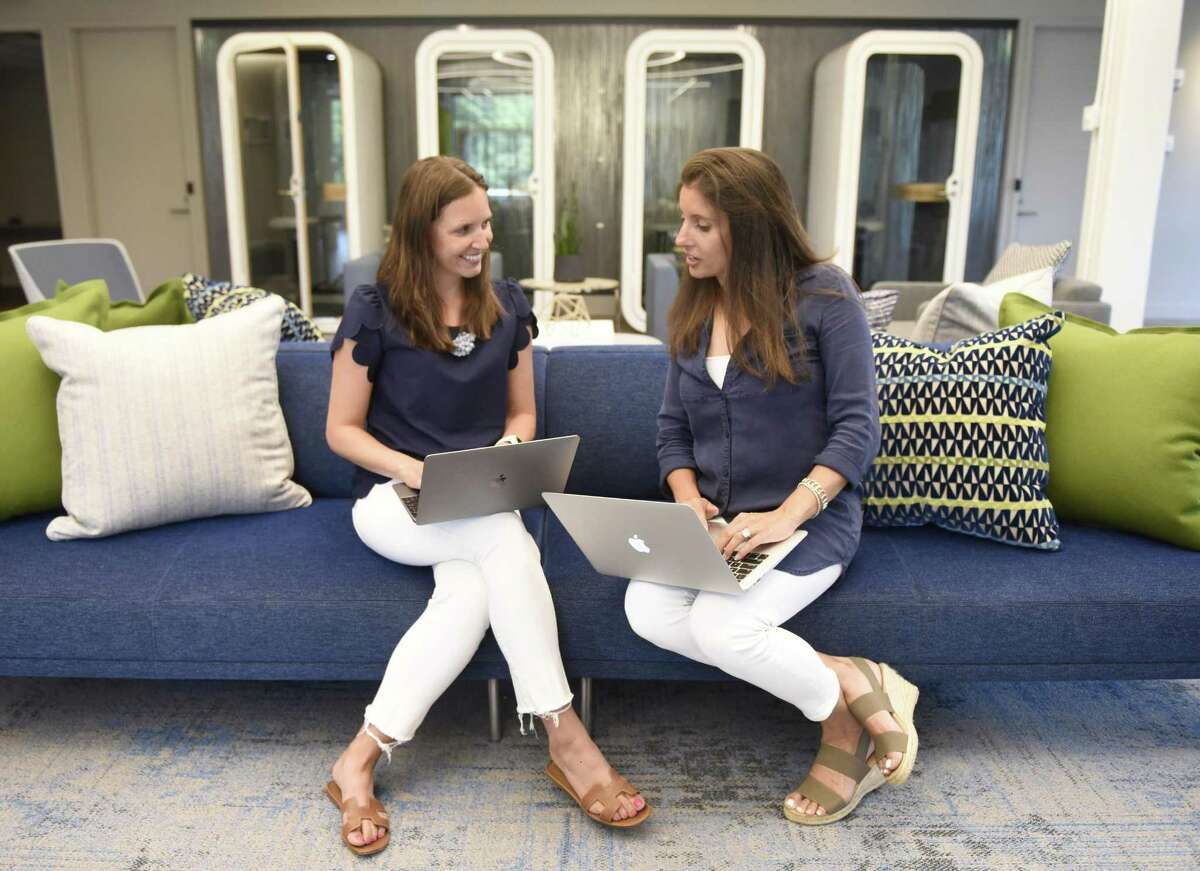 ABOVE: Greenwich Moms bloggers Megan Sullivan, left, and Layla Lisiewski pose at the Work Well Win co-working space in Greenwich, Conn. Monday, July 16, 2018. Greenwich Moms started locally but the network of moms expanded into a network that now spans the nation. RIGHT: A screenshot of the website.