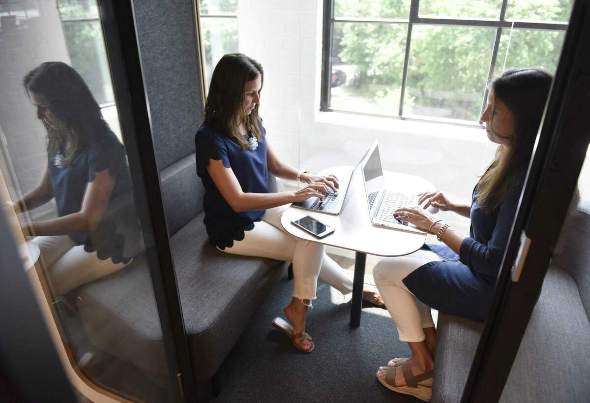 Greenwich Moms bloggers Megan Sullivan, left, and Layla Lisiewski pose at the Work Well Win co-working space in Greenwich, Conn. Monday, July 16, 2018. Greenwich Moms started locally but the network of moms expanded into a network that now spans the nation.