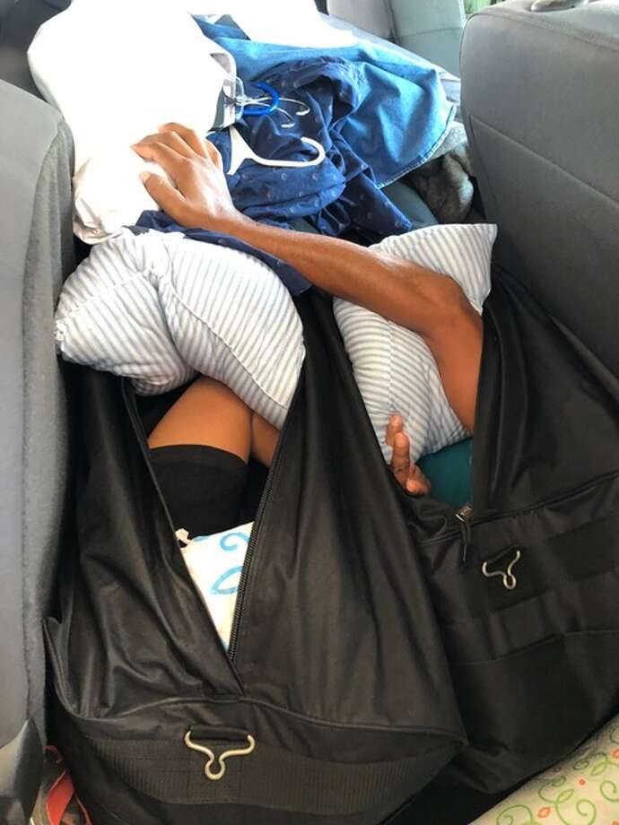Two undocumented immigrants were found hidden inside duffel bags. Photo: Courtesy