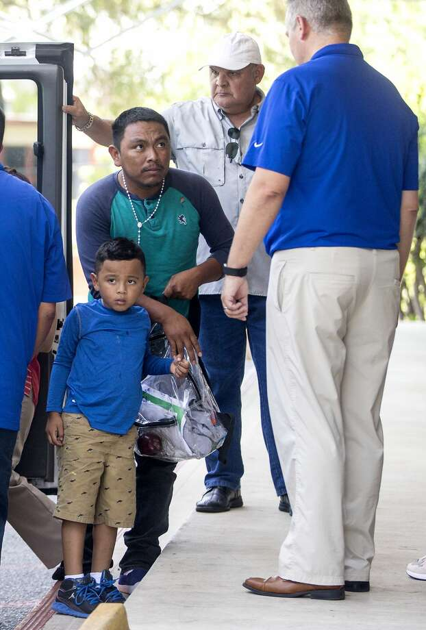 A man and a boy get out of an unmarked van Tuesday, July 17, 2018 at a Catholic Charities facility where reunited undocumented families are taken after they are released from Department of Homeland Security custody. The families were separated as part of the Trump administration's so-called zero tolerance policy. Photo: William Luther/Staff Photographer